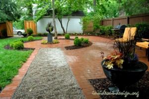 Brick pavers with circle detail and pea gravel path
