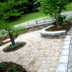Lewis Memorial, pavers, sitting walls, and landscaping at installation.