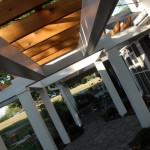 The arbor columns were painted a very light gray and beefy rough cedar beams used on top.