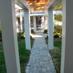 Lewis The path from the garage to the screen porch provides a nice level walking surface for the homeowner.