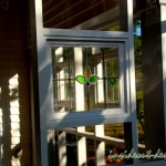 Stained glass detail in the screened porch.