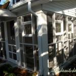 The screened porch was added, and we worked in the stained glass antique pieces the owner had collected.