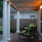 The elevated porch was added for a quaint sitting area with 4 columns and cedar beams.