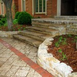 Natural stone stairs, dry stacked wall, paver and natural stone porch, paver driveway and brick border detail