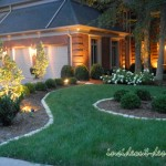 Stone curbing around landscape beds, landscaping, lighting, and driveways