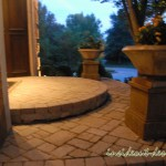 Westerfield porch pavers with dramatic curved step and containers