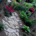 10-The rain garden was created to capture the runoff from the patio as well as the gutters.  This rock placement allows the water to flow gracefully t