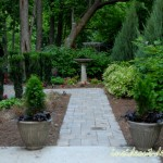 05-The entry to the garden is flanked with two containers and an old bird bath is centered at the end.