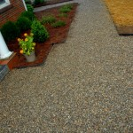 The pea gravel walk is 4' wide and enlarges at the entry to define the entry door as the main door for visitors.