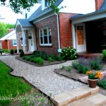 The new pea gravel walk is soft and goes with the architecture of the home, and helped keep the project under budget.