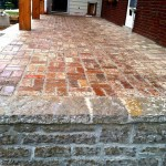 24-The raised limestone porch with reclaimed brick patio.