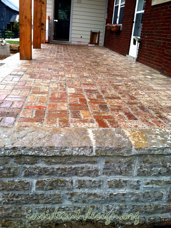 24 The Raised Limestone Porch With Reclaimed Brick Patio.
