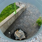 Looking down from the green roof, you can see the boulder water feature and pavers.