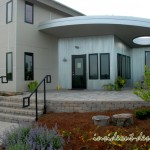 The front of the office includes a Belgard Weston wall and stairs and Belgard Urbana pavers.